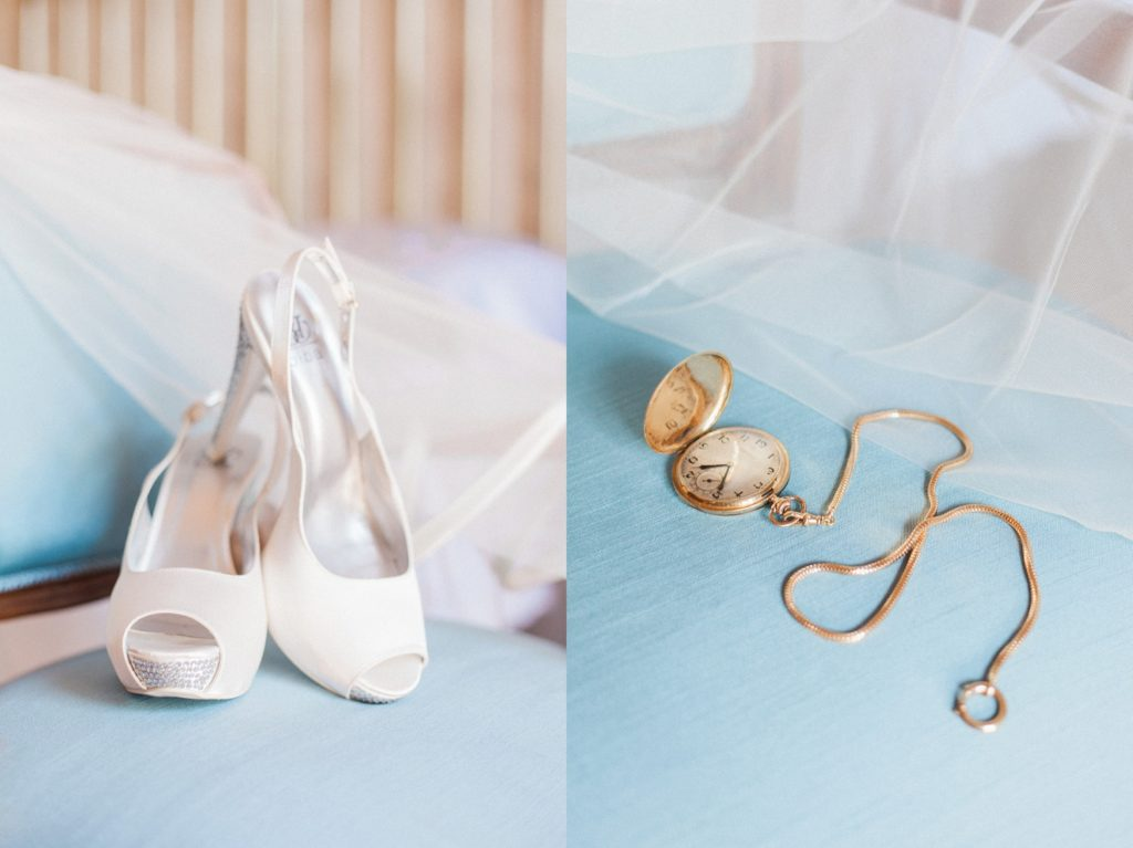 Detail image of the brides wedding shoes and a gold pocket watch