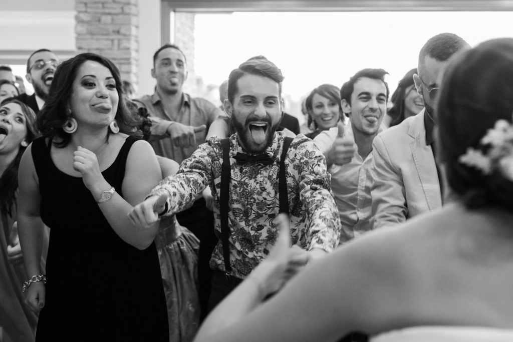 Wedding guests dance during a reception at the Convivium Hotel in Abruzzo