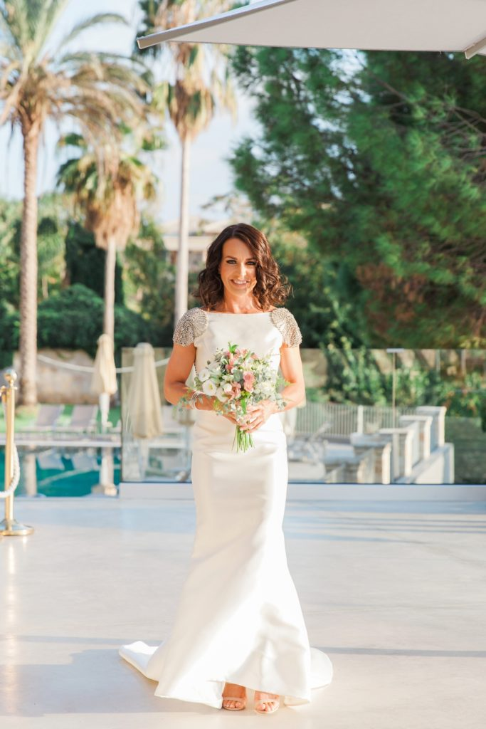 Bride makes her way to her ceremony at Domotel Agios Nikolaos in Sivota