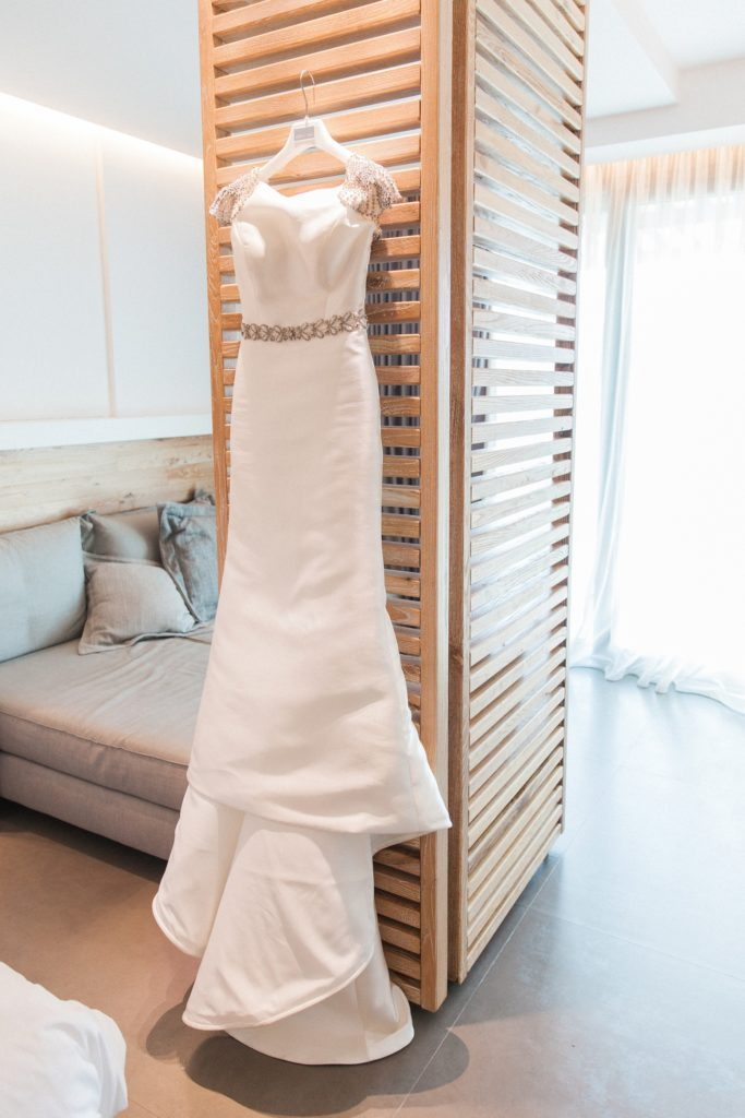 Rosa Clara wedding dress hanging in a suite at Domotel Agios Nikolaos in Sivota