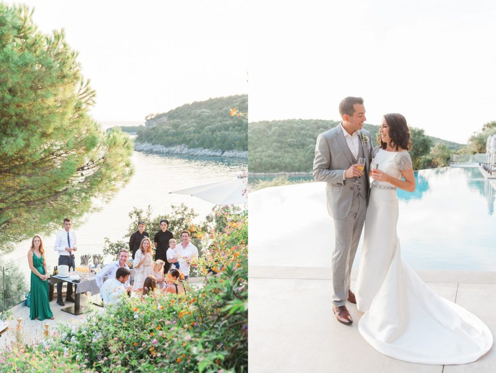 Couple and their guests on a terrace enjoying drinks and canapes after the wedding ceremony