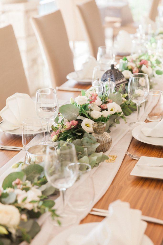 Wedding breakfast table with pink and white decor at Domotel Agios Nikolaos in Sivota