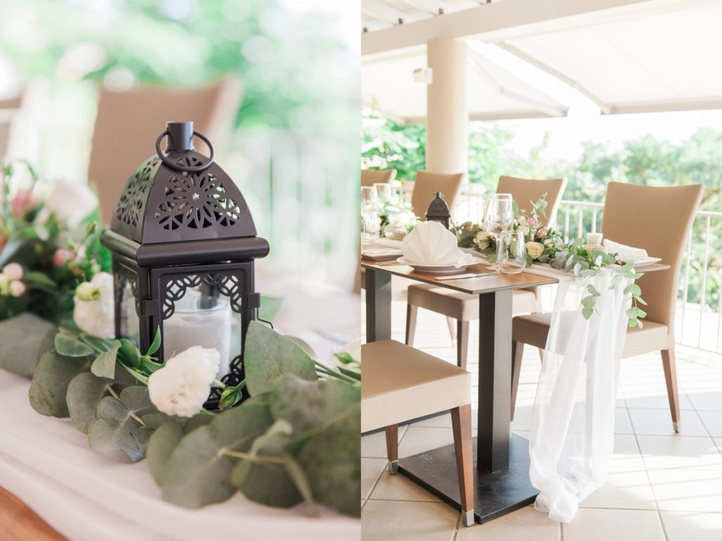 Wedding table decor with sand coloured leather chairs and black lantern centrepieces at Domotel Agios Nikolaos in Sivota