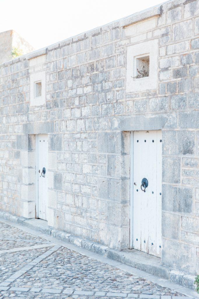 White doors in the Santa Maura Castle of Lefkada Greece