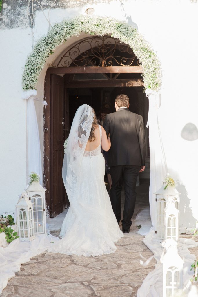Bride and groom make their way into the church of Santa Maura Castle