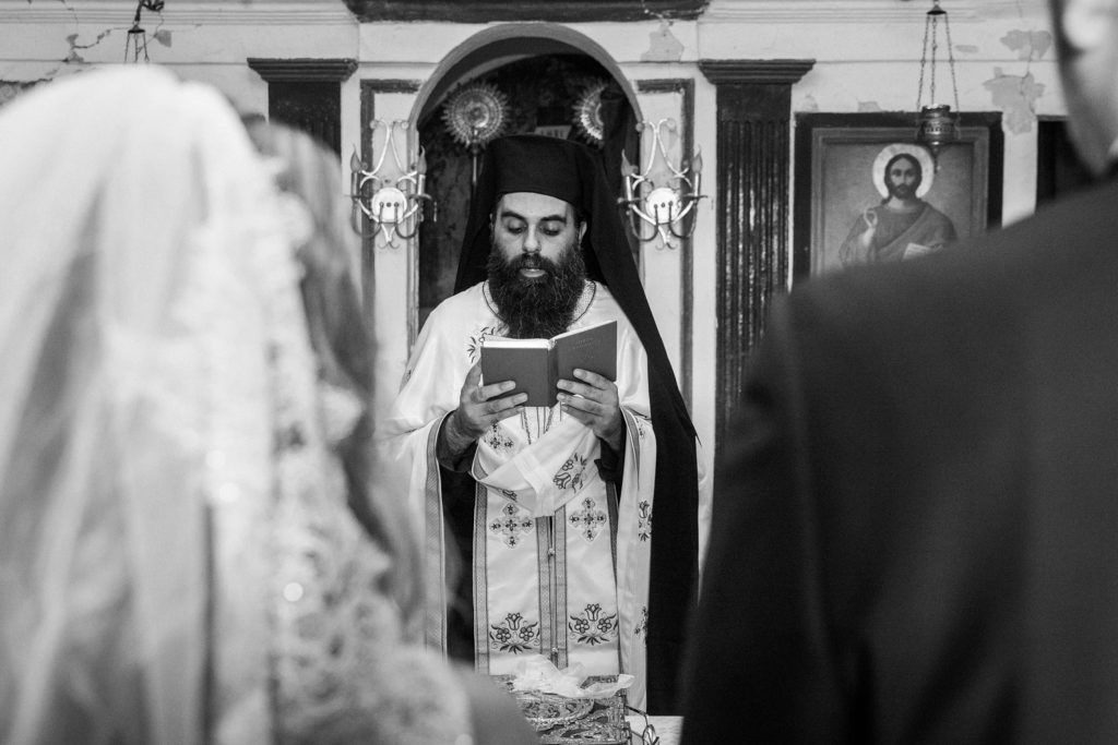 Greek Priest during the traditional Greek wedding ceremony