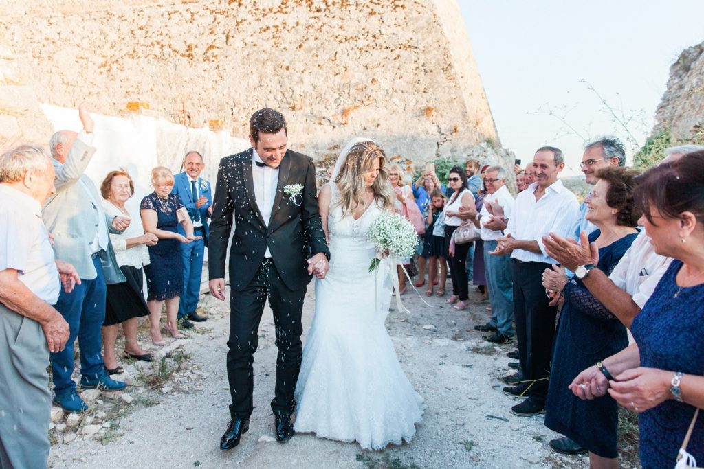 Couple are showered in rice as they leave the church in Santa Maura Castle in Lefkada