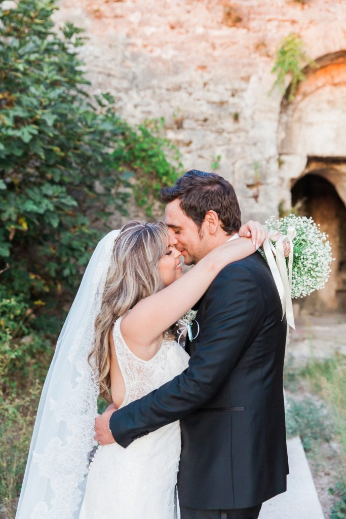 Bride and groom share a moment after their wedding at Santa Maura Castle in Lefkada