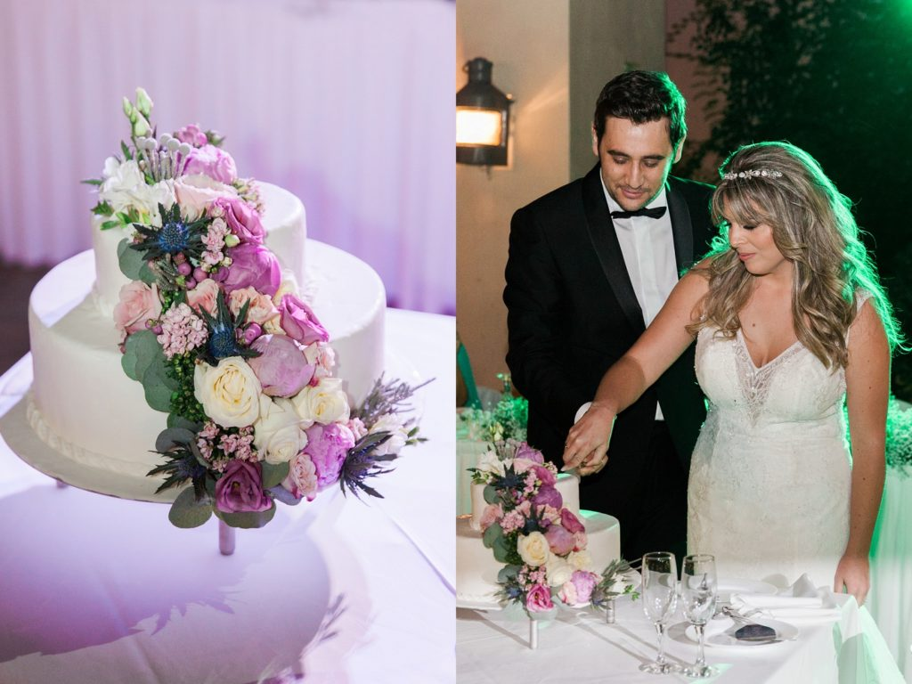 White wedding cake with cascading flower detail and portait of the couple cutting the cake