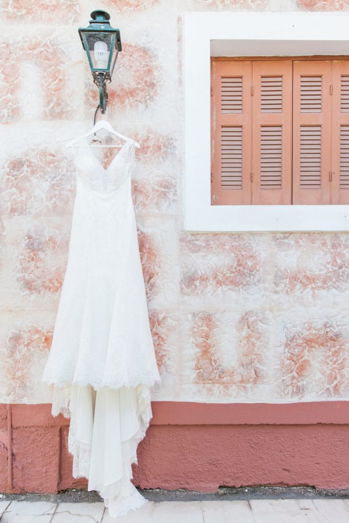Brides Pronovias wedding dress hanging on the strees of Lefkada