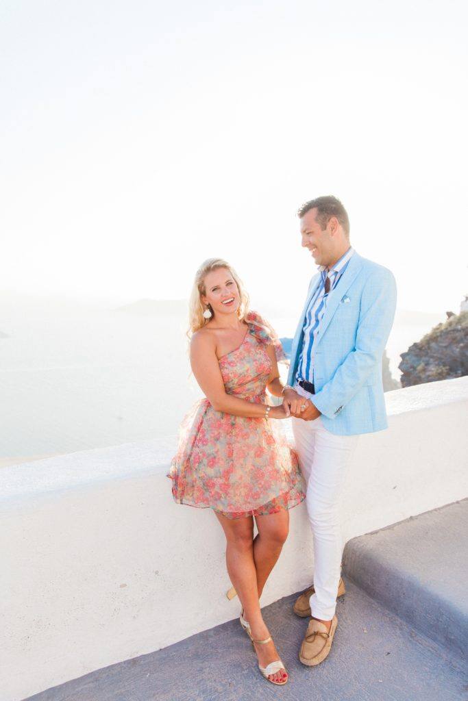 Bride smiles with her husband during their Santorini honeymoon photography session