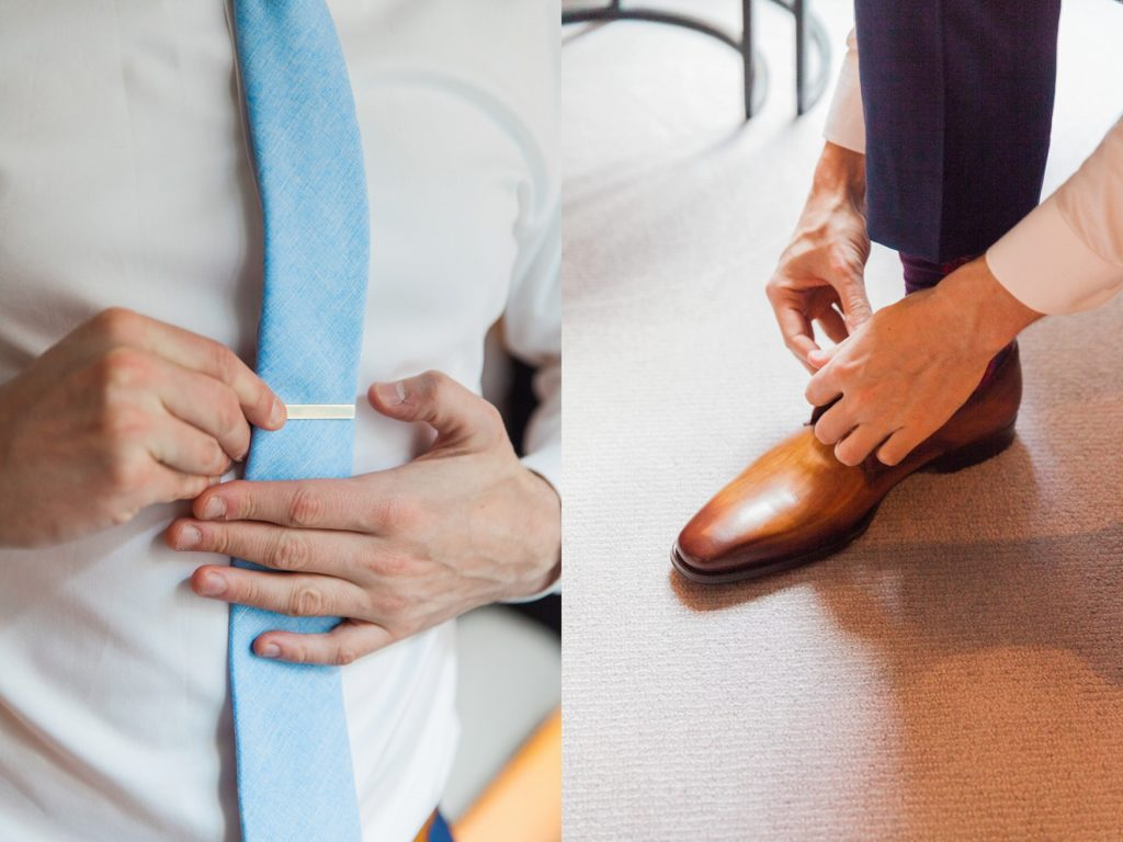Groom fastening his tie and putting on his shoes on the morning of his wedding