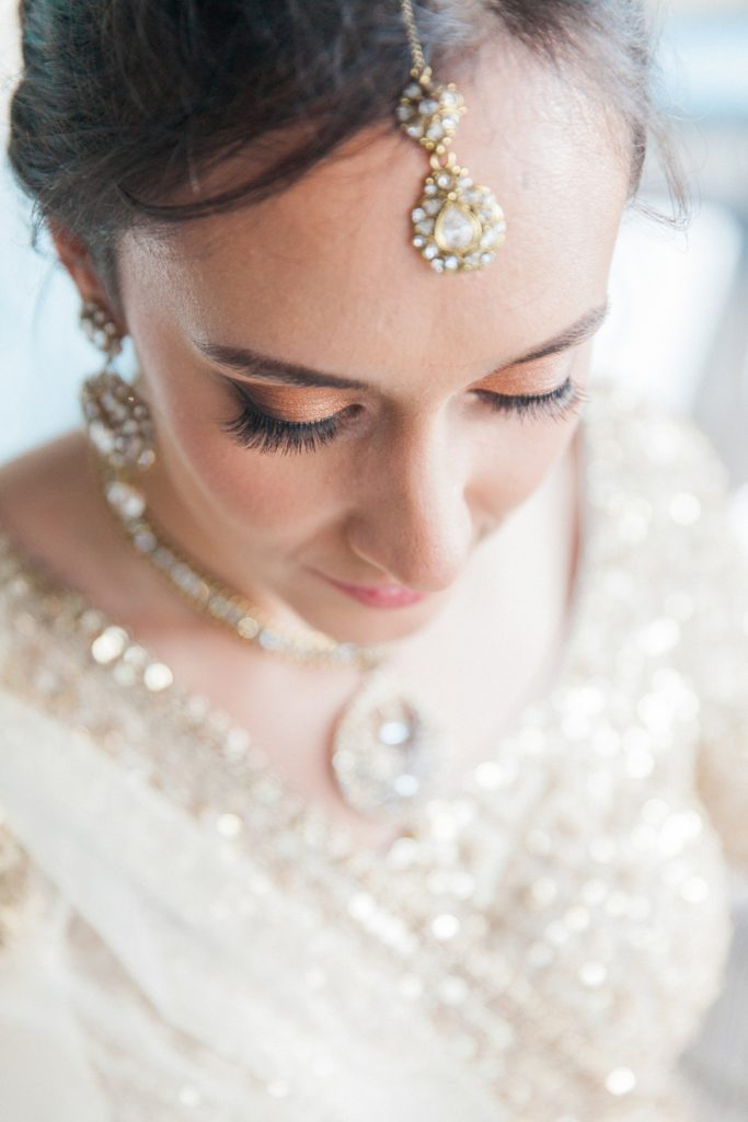 Portrait of an Indian bride showing her make up and traditional Indian jewellery