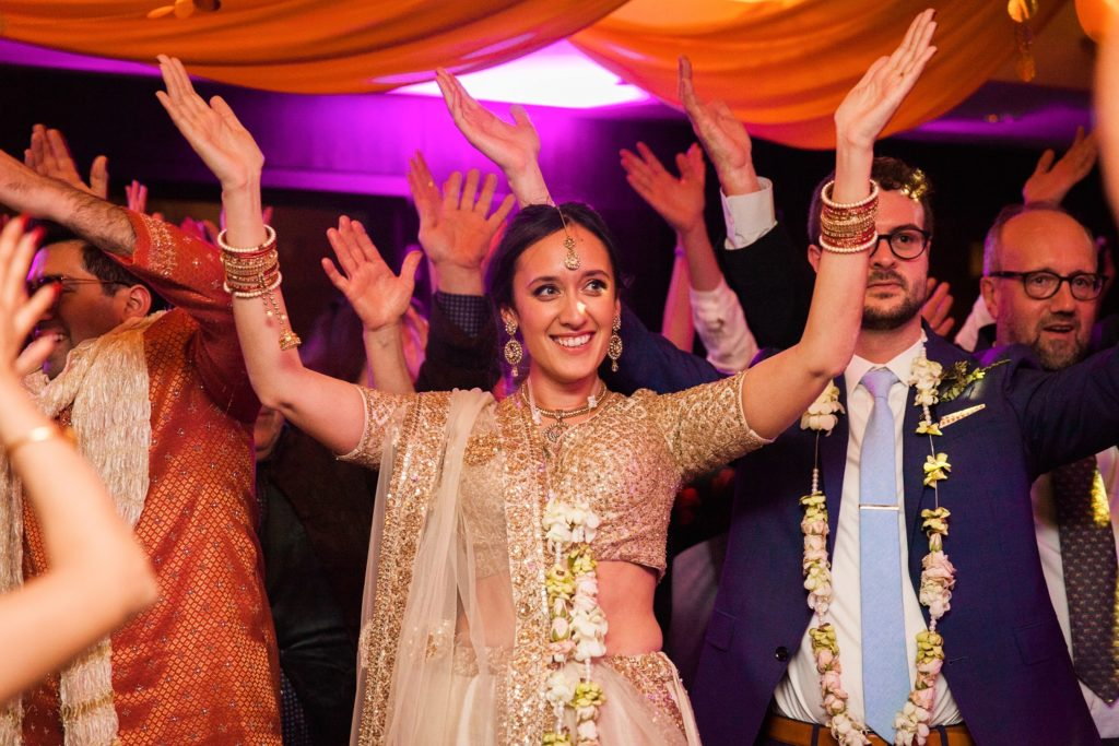 Indian bride dances during her wedding at South Place Hotel in London