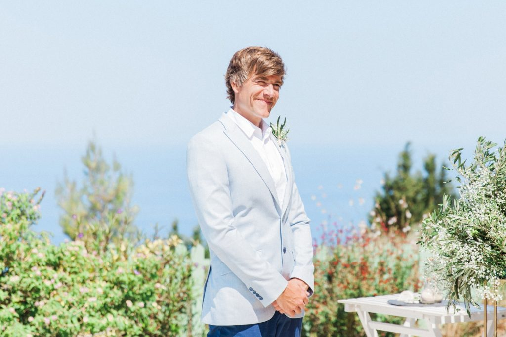 Groom smiles as the bride arrives at their villa elopement ceremony