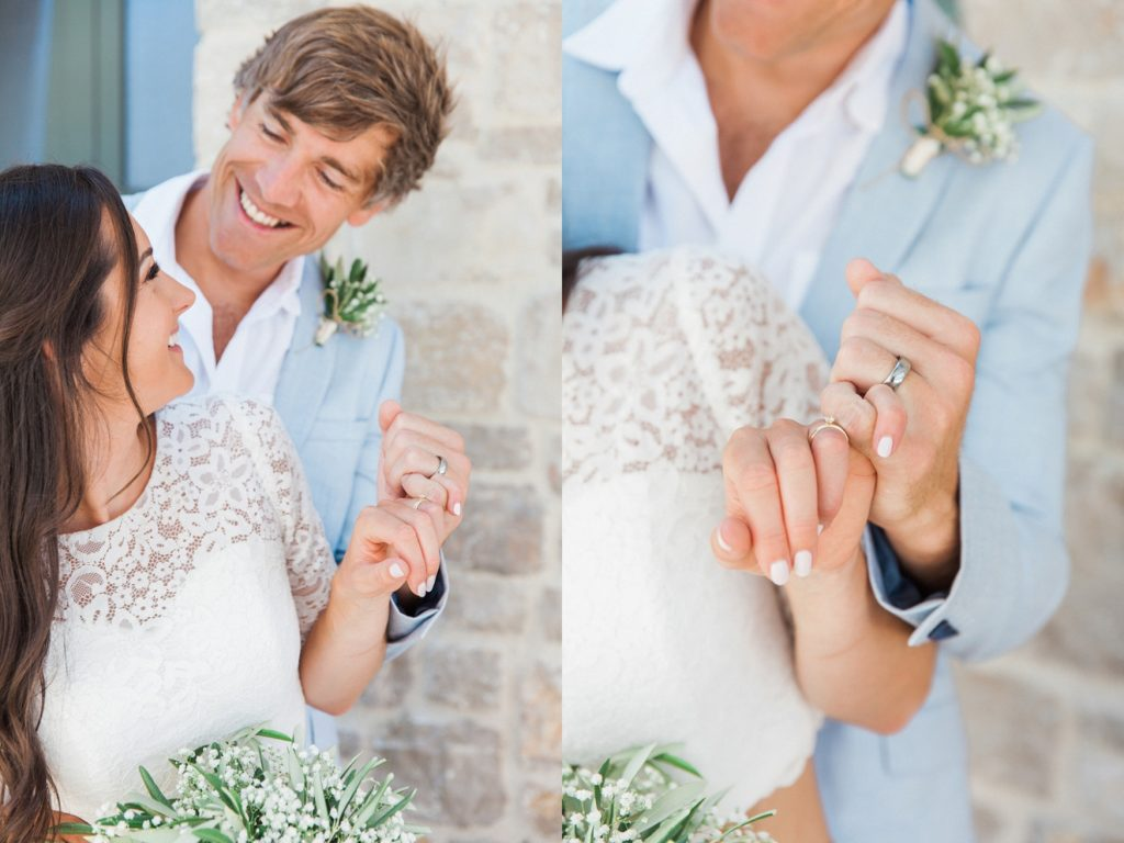 Couple share a laugh while making a 'pinky promise' on their wedding day