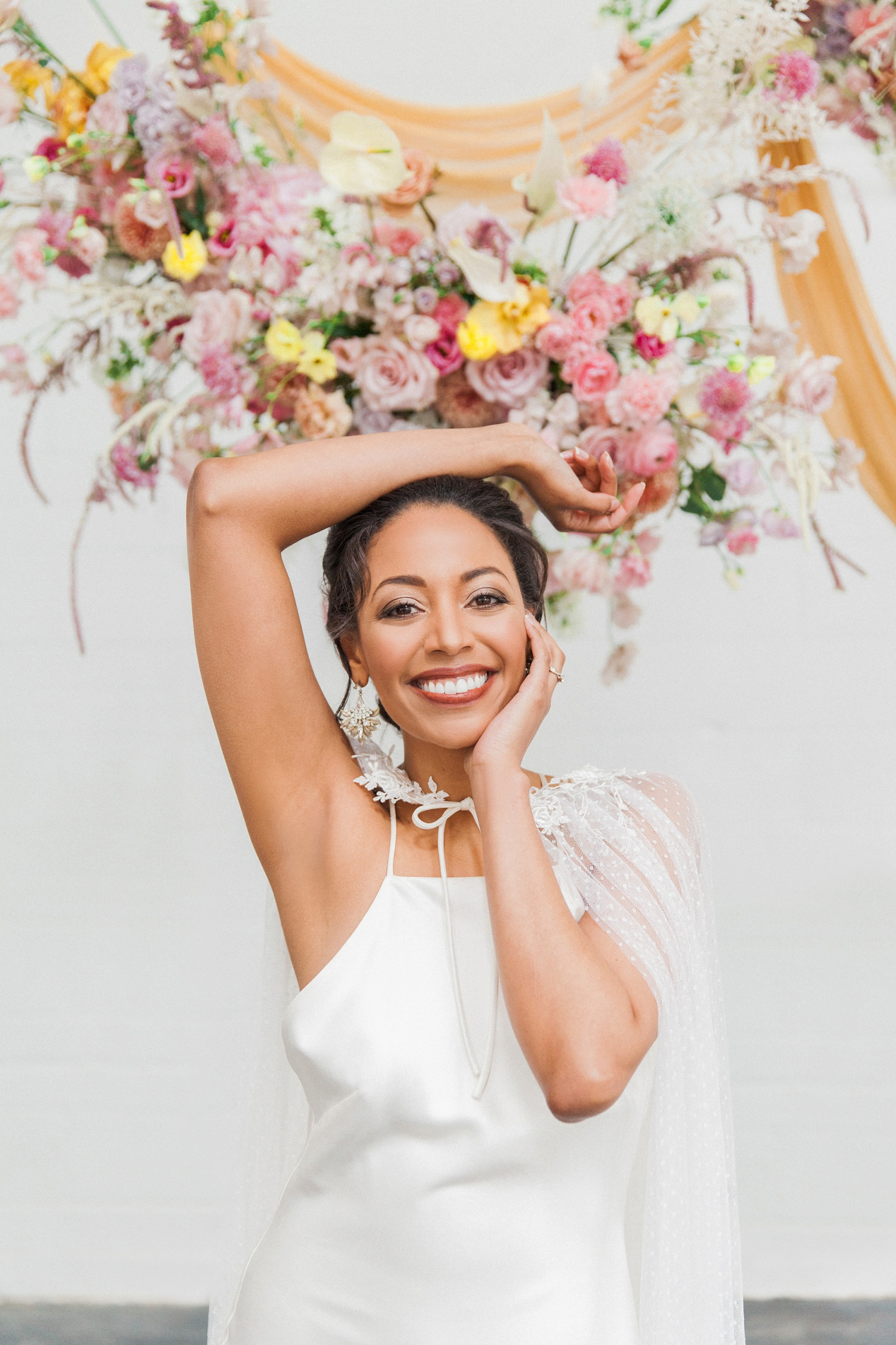 Colourful spring wedding editorial in London featuring a beautiful mixed race bride