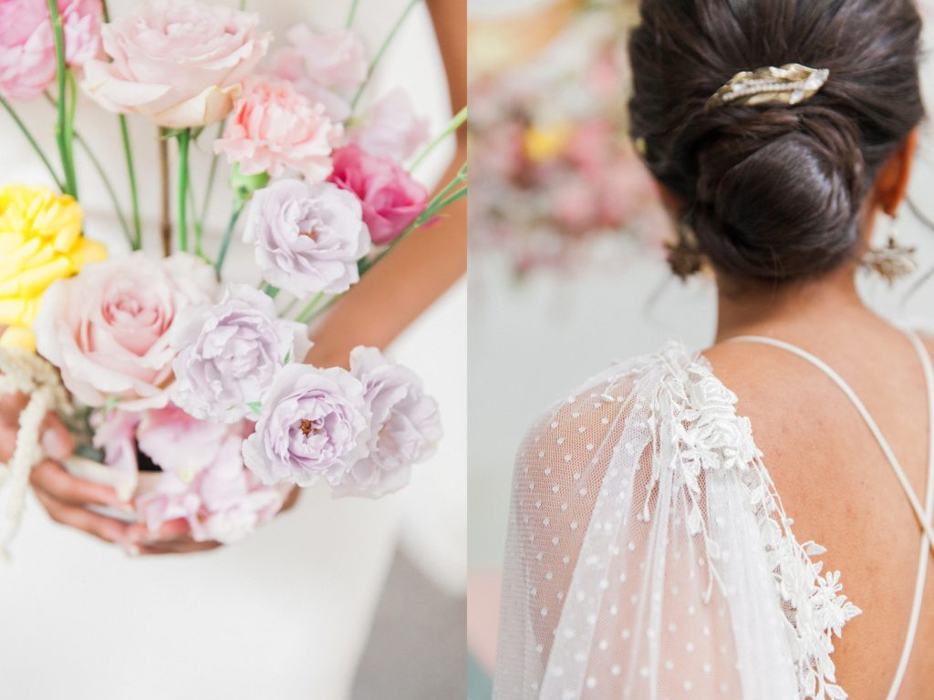 Bride holds a spring wedding arrangement while showing off her antique hair accessories