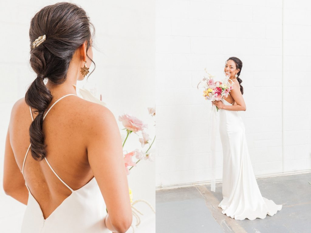 Black bride wearing a Halfpenny London wedding dress holds a bridal bouquet featuring dried flowers, anthuriums and orchids