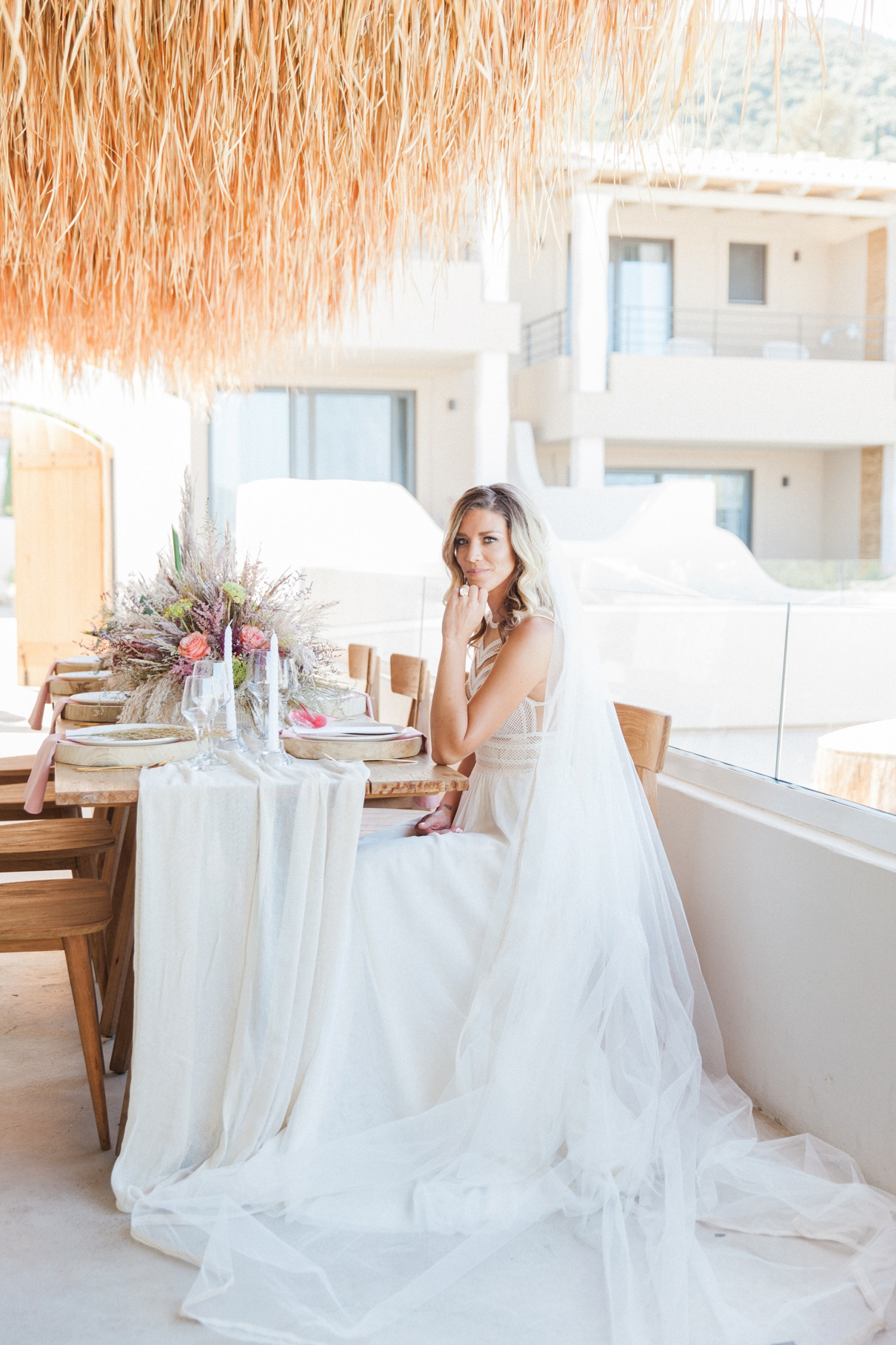 Bride sitting at her wedding reception table at Crystal Waters Lefkada