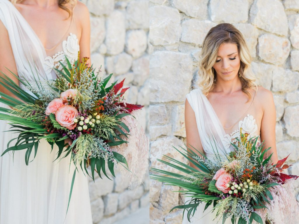 Bride in an Atelier Zolotas wedding gown with a boho bouquet featuring roses, palm leaves and pampas grass