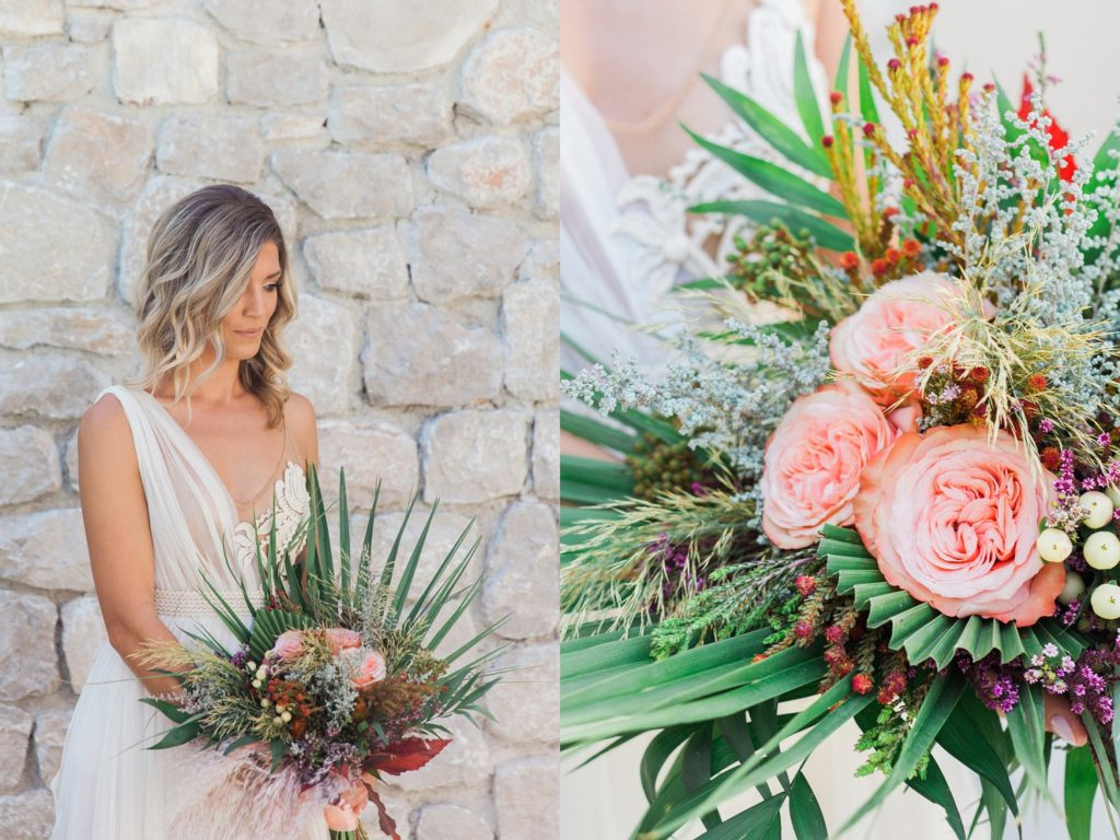 Portrait of a bride in an Atelier Zolotas wedding gown with a bridal bouquet featuring roses, pampas grass and palm leaves