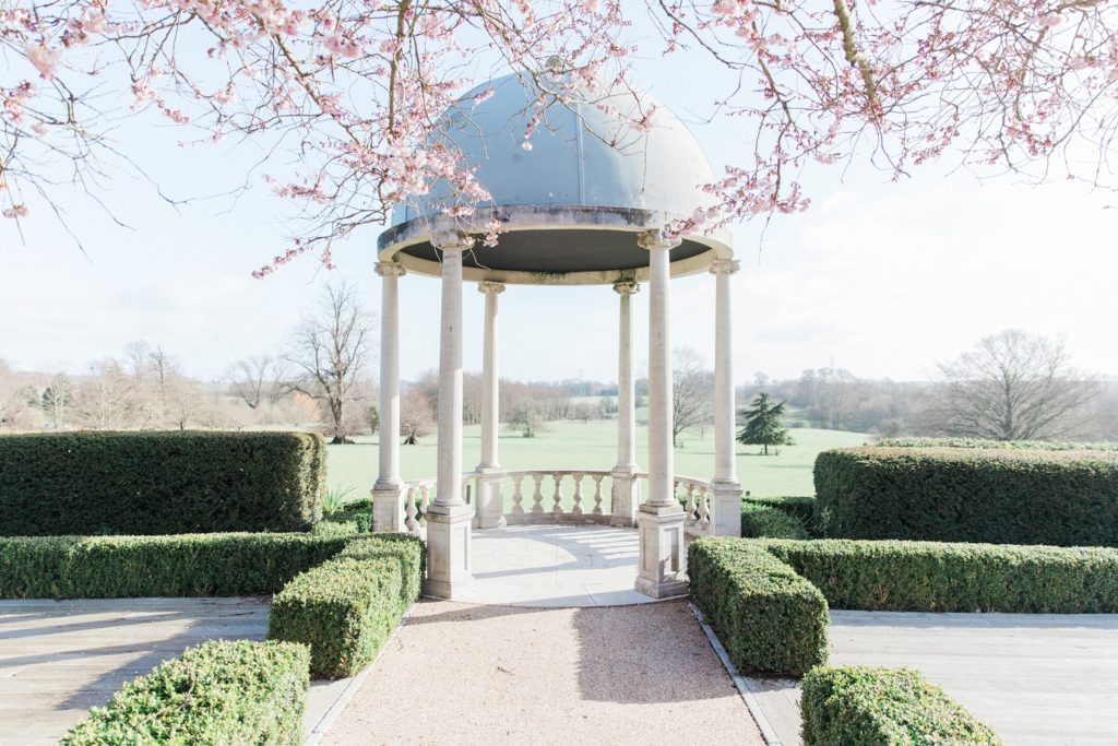 Wedding gazebo with cherryblossoms in the manicured gardens of Froyle Park