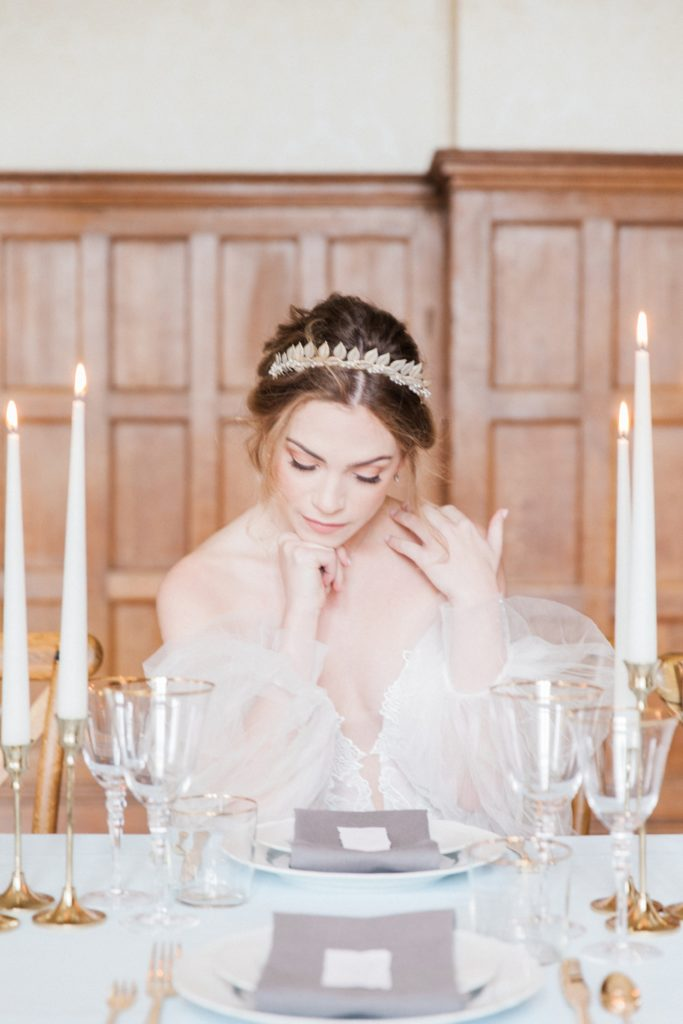 Bride sitting at an elegant reception table at her Froyle Park wedding