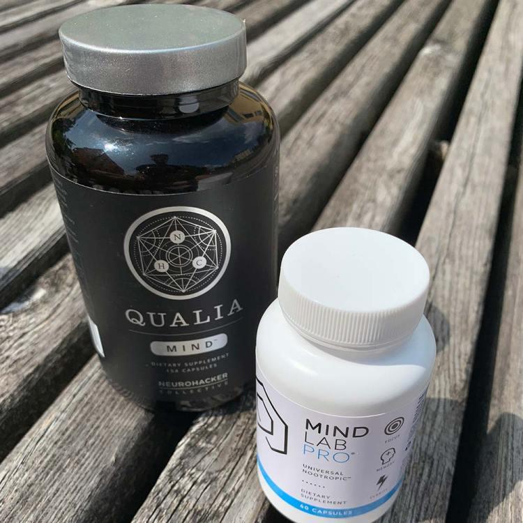 A bottle of Qualia Mind and a bottle of Mind Lab Pro