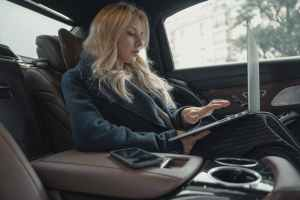 woman using laptop while in the car