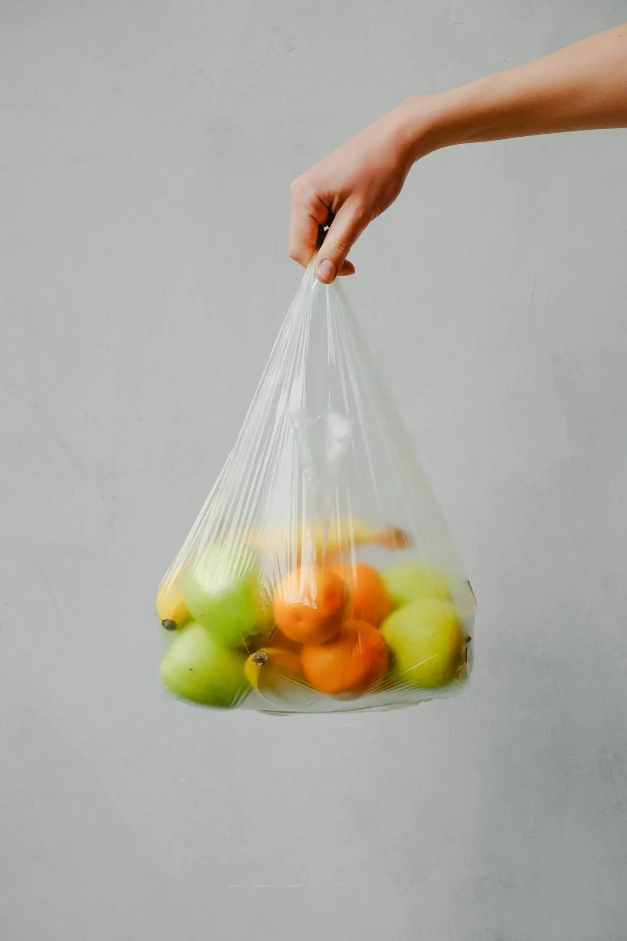 plastic bag with fruits in it