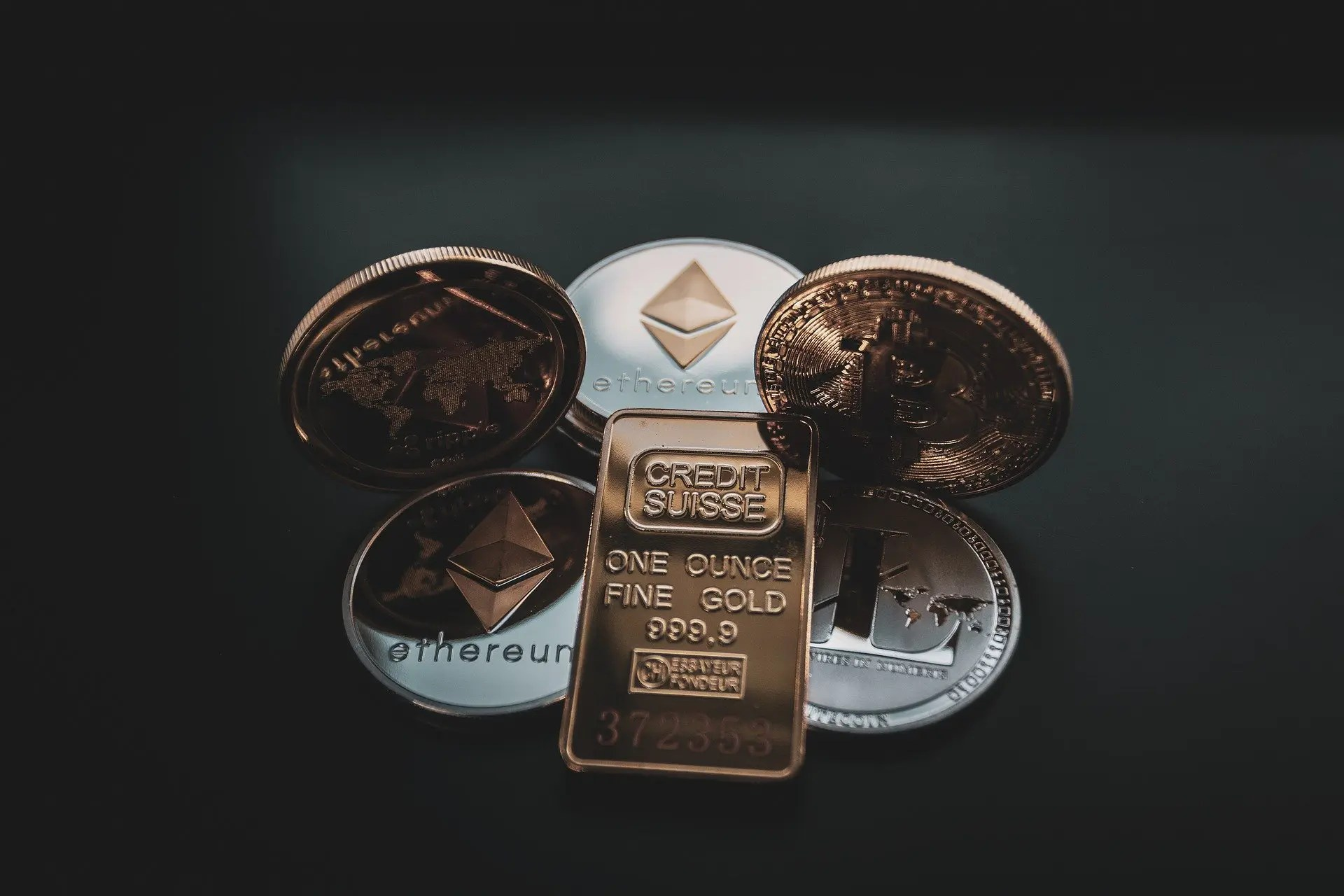 cryptocurrency coins and Swiss gold ounce