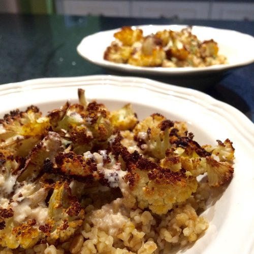 roasted cauliflower and freekeh with garlic tahini miso dressing