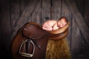 newborn in a saddle
