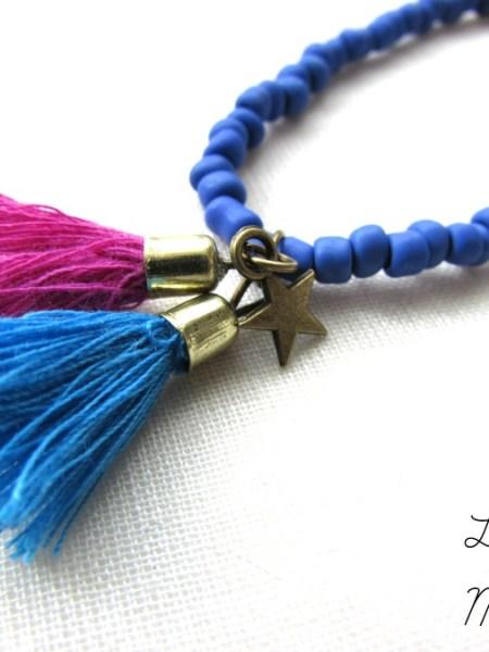 """Collier """"Little Manouche"""" - jeu de couleurs perles de rocailles, pompons, étoile"""