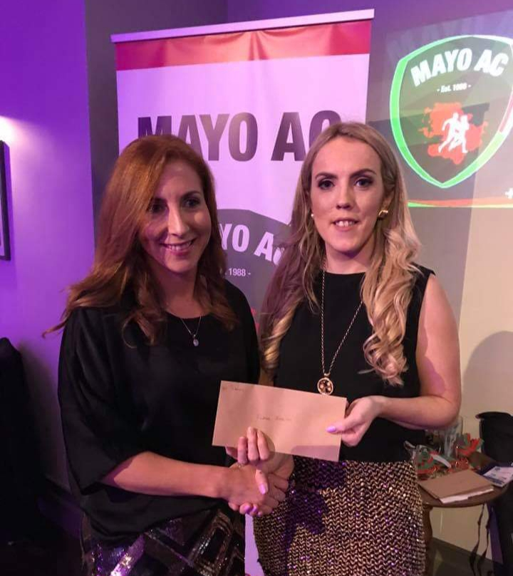Elaine Hession winner 2018 Mayo AC Vodafone women's club league receives her prize from Maria Kneafsey
