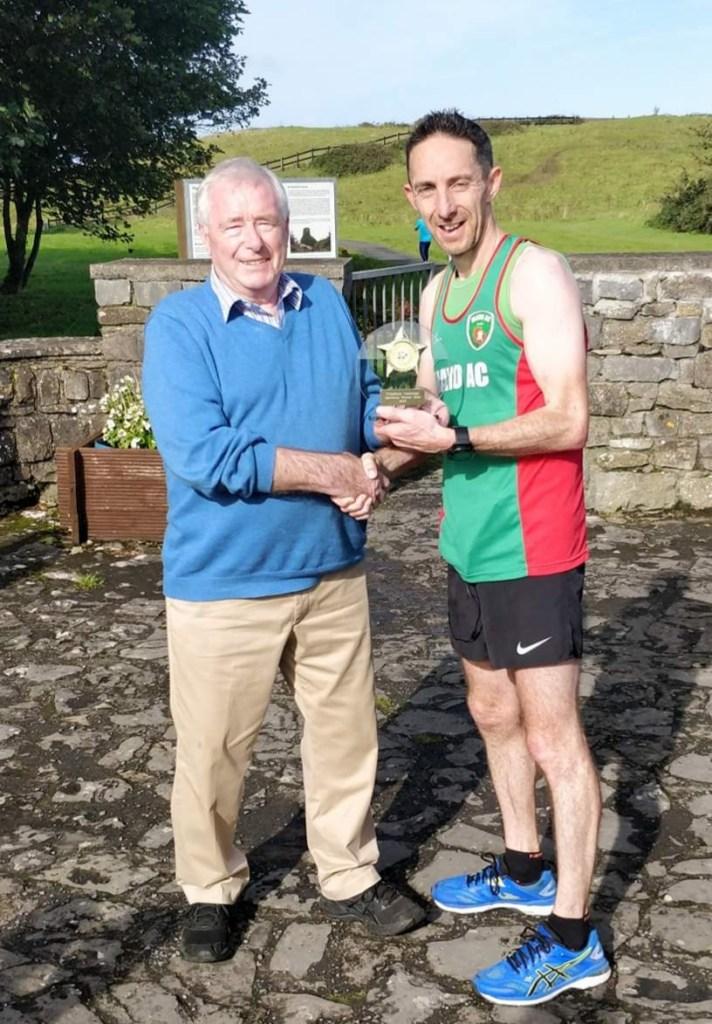 Enniscrone marathon winner John Gordon receives his prize