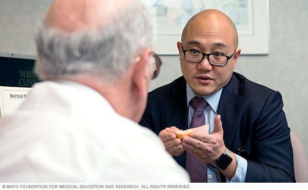 Surgeon consults with prostate cancer patient