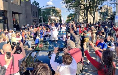 Crowd celebrating on Ouellette street with Spitfire Players and the Mastercard Memorial Cup