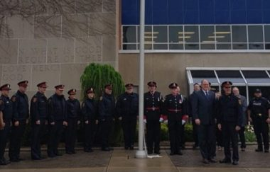 Windsor Police with Mayor Drew Dilkens in front of City Hall