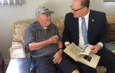 Mayor talking to a elderly man