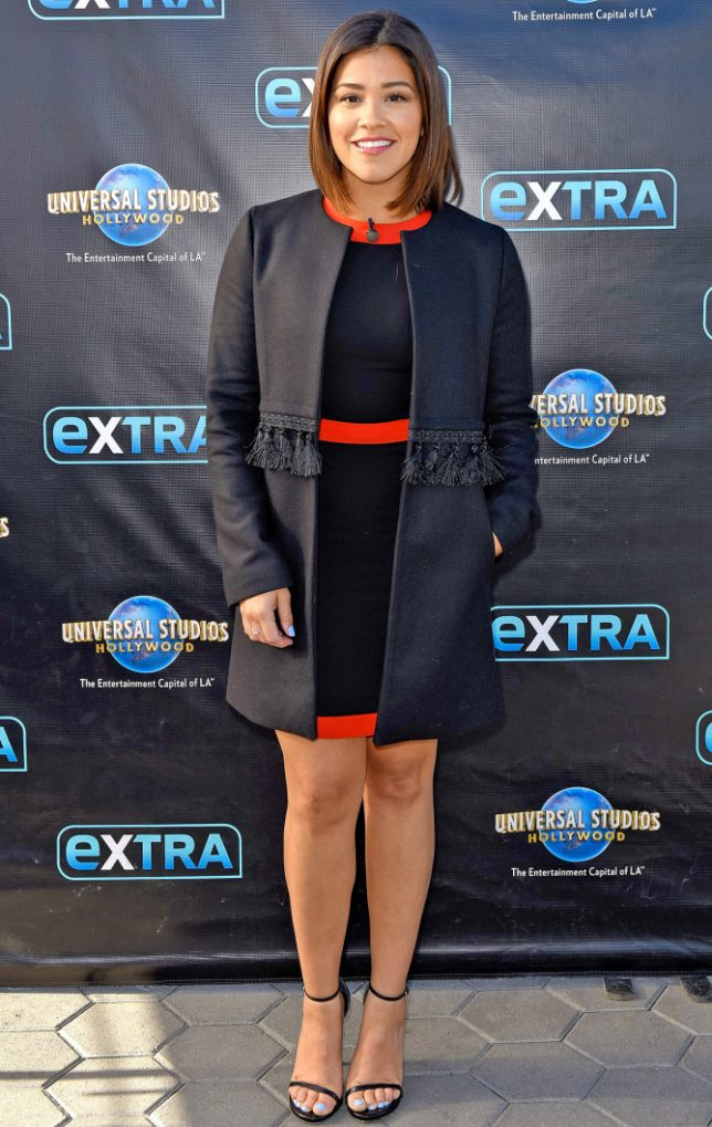 "UNIVERSAL CITY, CA - NOVEMBER 30:  Gina Rodriguez visits ""Extra"" at Universal Studios Hollywood on November 30, 2016 in Universal City, California.  (Photo by Noel Vasquez/Getty Images)"