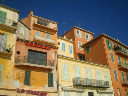 Shutters on the weathered buildings of Villefranche sur Mer, France