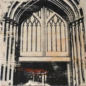 Solemn architectural door on the front of St Cuthbert's church in Edinburgh, Scotland.