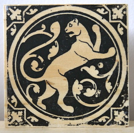 medieval lion, mountain lions, sainte chapelle, paris france, medieval tiles, religious iconography, circles and geometric designs, inlaid inlay floor tiles