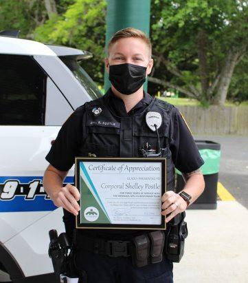 Corporal Shelley Postle accepting a Certificate of Appreciation