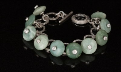Seafoam and other light green jade stones with silver centers on handmade silver bracelet  Carol Holaday