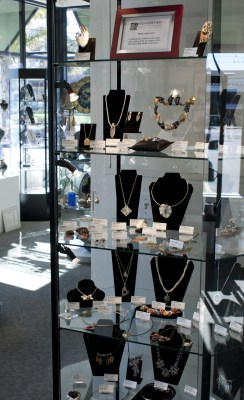 Tall case full of jewelry  the MBMAG artists at theMany Hands Gallery Show: Made with Love 2011