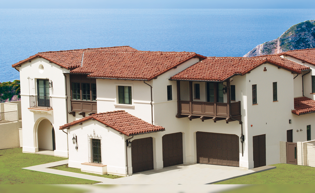 Classic Tapered Mission clay roof tile in 30% Custom Mahogany and 70% Custom Burnt Sienna with requa eave application
