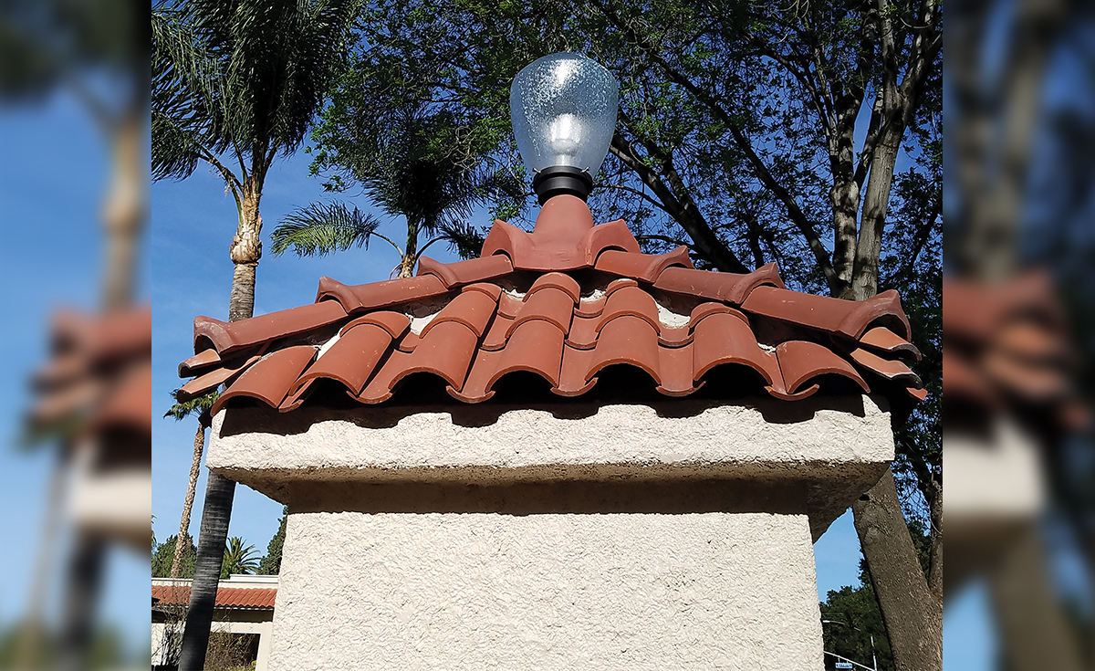 Detail of Wood Street Monuments historical clay roof tile in Riverside, CA - Accurate replica tile and four forked ridge created to match.